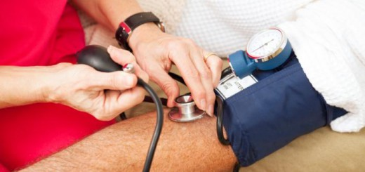 man-having-blood-pressure-checked